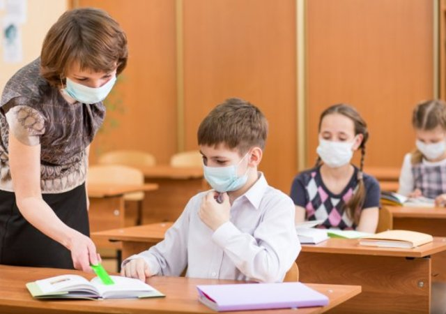 depositphotos_32704329_stock_photo_school_kids_and_teacher_with